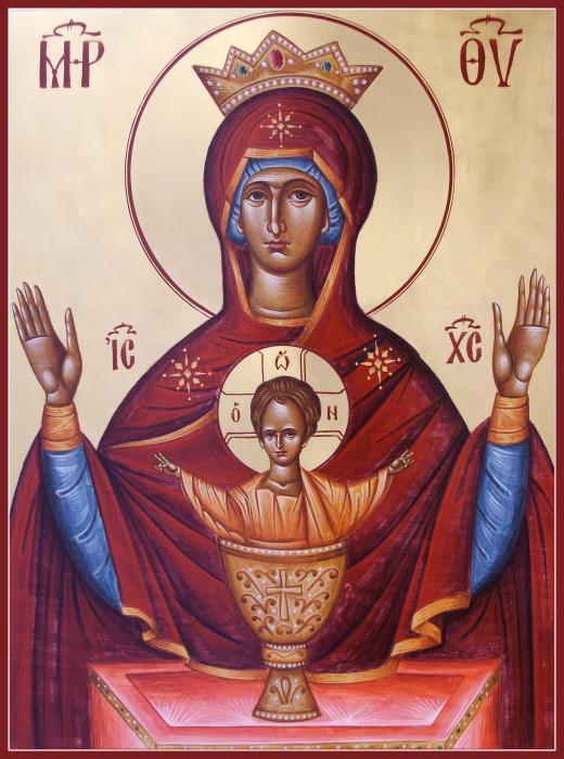 An icon of Mary, crowned, with the baby Jesus in a chalice before her