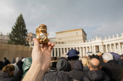 A statue of the baby Jesus from a Nativity scene is held up for the blessing at St. Peter's Sqaure on bambellini Sunday - December 15, 2013