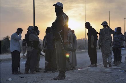 slamic State fighters stand guard at a checkpoint in the northern Iraqi city of Mosul (CNS)