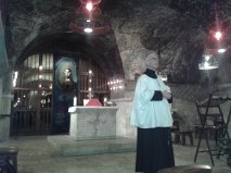 Francis Carey (pilgrimage organiser) giving a few words before Mass in the Crypt