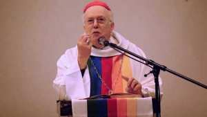 Cardinal Daneels in rainbow vestments