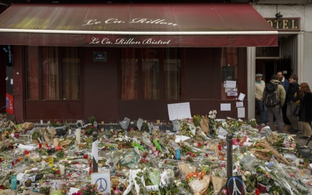 Flowers lay outside the Carillon cafe, a site of last Friday's attacks in Paris