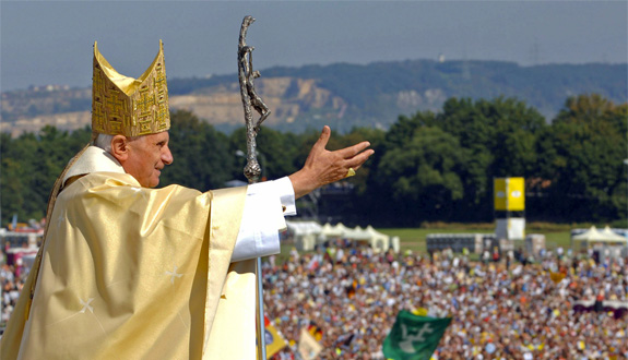 Pope Benedict XVI waves to pilgrims after a 2006 Mass on Islinger Field near Regensburg, Germany.