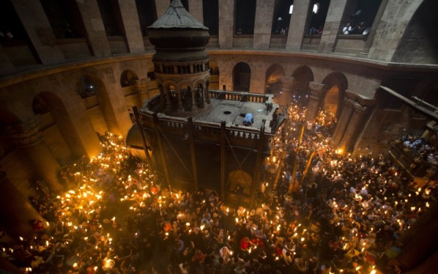 Orthodox pilgrims hold candles during the Holy Fire ceremony in the Church of the Holy Sepulchre