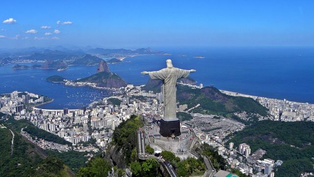 A panoramic view of the statue of the Holy Redeemer at the top of Corcovado Mountain, Rio de Janeiro, Brazil