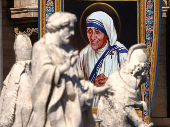 A tapestry depicting Mother Teresa is seen in the facade of St. Peter's Basilica during a mass, celebrated by Pope Francis, for her canonisation at St. Peter's Square in the Vatican on Sunday (Reuters)