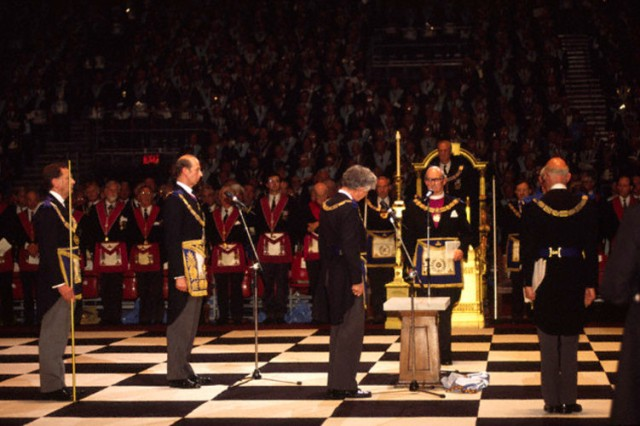 "London, UK --- ""Prince Edward, The Duke of Kent at a Masonic ceremony at Earls Court in London.  Freemasonry, which traces it's modern origins back to the sixteenth century is beased on principles of fraternity and secrecy. Members are sworn to keep silent on their activities and make themselves known to other Freemason's by way of signal (often a handshake)."" --- Image by © Stuart Freedman/In Pictures/Corbis"